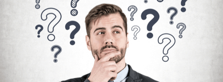 Man pondering hand on face with question marks over head FAQ image
